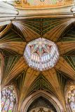 Octagon roof of Ely cathedral. The Octagon roof at Ely cathedral with stained glass windows, arches and painted panels of angels Royalty Free Stock Photo
