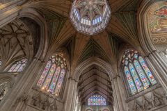 Octagon roof of Ely cathedral. The Octagon roof at Ely cathedral with stained glass windows and painted angels Stock Photos