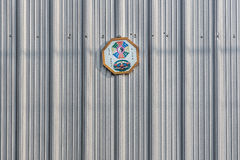 Octagon Shaped Pakua Mirror hanging on metal wall Stock Images