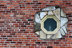 Interesting window in brick wall Stock Photography