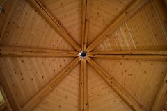 Octagonal shape of a playhouse`s ceiling. Made of wood royalty free stock photos