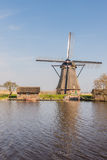 Octagonal thatched windmill in Kinderdijk Netherlands Royalty Free Stock Photography
