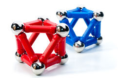 Octahedrons. Red and blue octahedrons made of magnets Royalty Free Stock Image