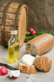 Octave, bread and cheese are on sacking. Octave, bread, vegetable oil and cheese are on sacking Stock Photography