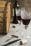 Octave and two wineglasses are on sacking. Octave, bottle and two wineglasses are on sacking Stock Photo