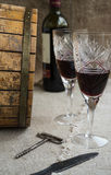 Octave and two wineglasses are on sacking. Octave bottle and two wineglasses are on sacking Royalty Free Stock Photo