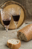 Octave and two wineglasses are on sacking. Octave, bread and two wineglasses are on sacking Stock Photography