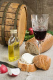 Octave, wineglass, bread and cheese are on sacking Stock Images