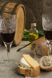 Octave, wineglass, bread and cheese are on sacking Stock Photo