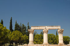 Octavia Temple. In ancient Korinth surrounded by Pine and Cypress trees stock images