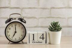 Free October 14 On A Wooden Calendar Next To The Alarm Clock, The Date Of The Autumn Month Royalty Free Stock Photos - 192399958