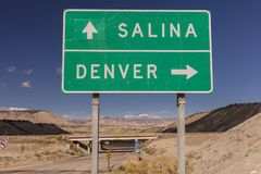 American Road Signs along roadways. OCTOBER 2017 - American Road Signs along roadways - shows directions to Salina and Denver Stock Image