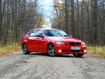 October 16, 2016; Arzamas, Russia; BMW 3 Series E90 Departure outside the city. BMW 3 Series E90 Departure outside the city car auto red road stock photography