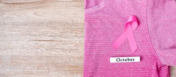 Free October Breast Cancer Awareness Month,  Pink Ribbon On Pink Shirt For Supporting People Living And Illness. Healthcare, Stock Image - 157631151