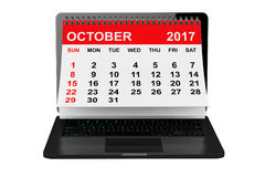 October 2017 calendar over laptop screen. 3d rendering. 2017 year calendar. October calendar over laptop screen on a white background. 3d rendering Royalty Free Stock Image