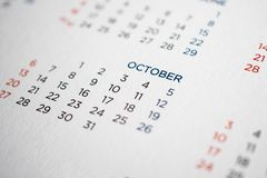 October calendar page with months and dates. Closeup stock photography
