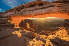 Sunrise behind Mesa Arch in Canyonlands National Park, Utah stock photography