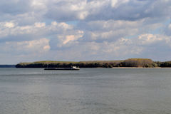 October cold Danube. Autumn cold and picturesque Danube. Commercial vessels transiting the river upstream and downstream stock photos
