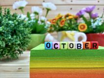 October. Colorful cube letters on sticky note block. stock photos