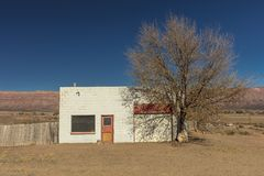 Deserted home business white building near New Mexico and Colorado Border stock image
