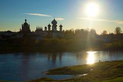 October evening on the river Tikhvinka. View of the Tikhvin Deiparous Uspensky monastery. Tikhvin Royalty Free Stock Image