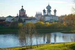 October evening on the Tikhvinka River. View of the temples of the Tikhvin Monastery, Russia Stock Photo
