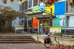 October 19, 2018 Germany. Clinic Helios Krefeld. Bicycle ecological mode of transport in Europe. Bicycle parking on the territory. Of the hospital clinic in stock photography