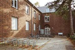 October 19, 2018 Germany. Clinic Helios Krefeld. Bicycle ecological mode of transport in Europe. Bicycle parking on the territory. Of the hospital clinic in royalty free stock image