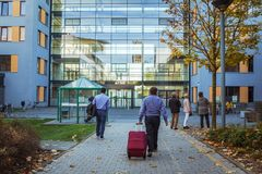 October 21, 2018. Germany, Krefeld. Entrance to Crefeld clinic in Helios, near the city of Dusseldorf. Modern European hospital. A. Male patient goes back with stock photos