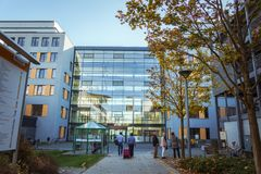 October 21, 2018. Germany, Krefeld. Entrance to Crefeld clinic in Helios, near the city of Dusseldorf. Modern European hospital. A. Male patient goes back with royalty free stock photos