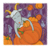 October goat. Happy goat hugs giant pumpkin Royalty Free Stock Photo