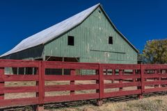 Green Barn with Sred fence around it south of Durango, Colorado. OCTOBER 8, 2017 -Green Barn with Sred fence around it south of Durango, Colorado Royalty Free Stock Image