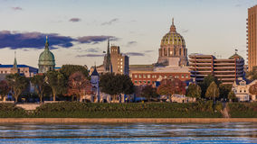 OCTOBER 25, 2016 - HARRISBURG, PENNSYLVANIA, City skyline and State Capitol shot at dusk from Susquehanna River, PA Stock Images