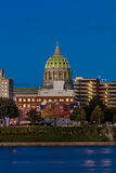 OCTOBER 25, 2016 - HARRISBURG, PENNSYLVANIA, City skyline and State Capitol shot at dusk from Susquehanna River, PA Stock Photography