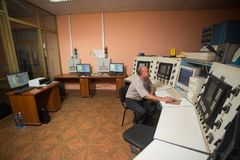 October 14, 2014. Kiev Ukraine. A middle-aged Caucasian man at work dispatcher plant control center, carefully analyzes the data stock photo