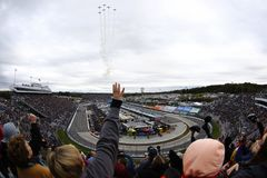 NASCAR: October 29 First Data 500. October 29, 2017 - Martinsville, Virginia, USA: Spectators look on during the National Anthem before the start of the First Stock Images