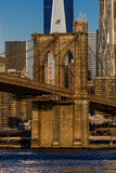 OCTOBER 24, 2016 - NEW YORK - Brooklyn Bridge and Manhattan Skyline features One World Trade Center at Sunrise, NY NY Royalty Free Stock Image