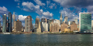 OCTOBER 24, 2016 - NEW YORK - Skyline of Midtown Manhattan seen from the East River showing the Chrysler Building and the United N Stock Photos