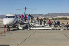 October 4, 2016 - Passengers climbing stairs to board airplane, Santa Barbara, CA stock image