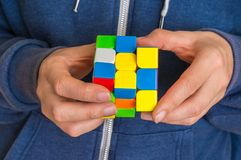 Rubik`s cube in female hands - game for solving problems. 5 OCTOBER 2017 PRAGUE, CZECH REPUBLIC: Rubik`s cube in female hands royalty free stock images