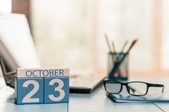 October 23rd. Day 23 of month, calendar on student workplace background. Autumn time. Empty space for text stock photos