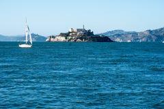 Sailboats sail in the bay near Alcatraz Island on a sunny autumn day. SAN FRANCISCO, CALIFORNIA: Sailboats sail in the bay near Alcatraz Island on a sunny autumn stock photography