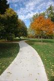 October Sidewalk. A picture of an October side walk with leaves Stock Photos