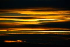 Sunset over river. Yellow and orange streaked skies of sunset over river Stock Images