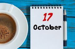 October 17th. Day 17 of month, calendar near coffee cup at Network Systems Analyst workplace background. Autumn time. Empty space for text royalty free stock image