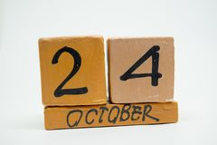 october 24th. Day 24 of month, handmade wood calendar isolated on white background. autumn month, day of the year concept stock photos