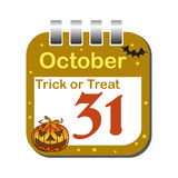 October thirty one calendar sheet. Isolated calendar sheet with pumpkin head, bat and the text trick or treat written above the date of 31 October. Halloween Royalty Free Stock Photos