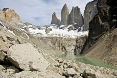 The Torres del Paine are reflected in the lagoon below stock image