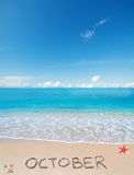 October on a tropical beach under clouds Stock Photos