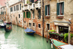 16 October 2016, Venice, Italy. Gondoleer sailing on the canals in a cloudy day. Royalty Free Stock Images